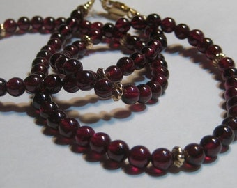 Beautiful Natural Garnet Beads with Gold Fill Beads .. approx 20 inches ...   e992