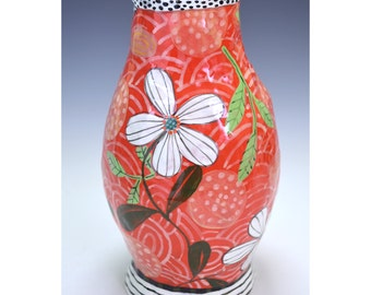 Vase. Red and round.