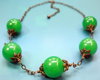 Bakelite necklace made of tested vintage 1950s opaque slightly swirled grass green bakelite beads and antiquecolor brass chain