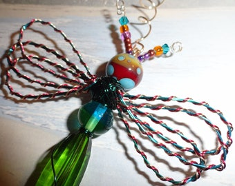 "My #9070 A Bug Eyed Red/Green Alien Fluttering Dragonfly!.. Ornament! Size 3.25""Wx4.5""L"