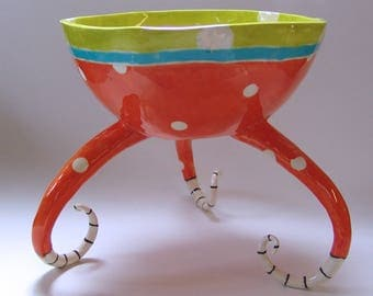 A Big Huge whimsical pottery Serving Bowl, bright Orange, Chartreuse & Turquoise with polka-dots and curly striped beetlejuice legs