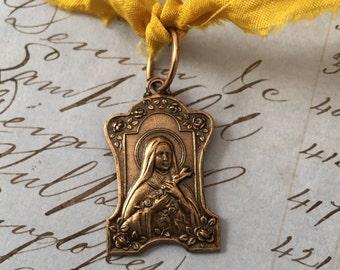 Saint Teresa Medal Antiqued Brass - Milagros - Saints - Religious