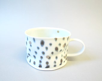 Silver dotted porcelain cup