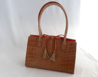 """Liz Clairborne purse, brown purse, faux alligator, bow with tassels, zip pocket, snap closure, 6""""x9"""", 7"""" handle, fabric lined, coral inside"""