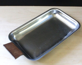 Vintage stainless steel small dish with wooden handle.