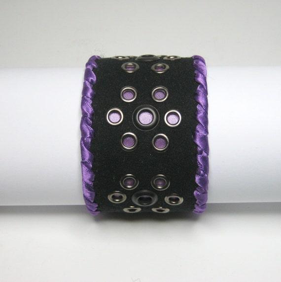 FABRIC CUFF BRACELET: Art piece, black with purple ribbon and eyelets detailing.  Medium. Handmade.