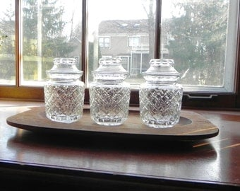 Vintage apothecary jars on a wood tray - pressed glass organization organized trio three