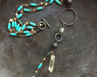 Turquoise rosary chain style dangle necklace with eclectic metallic boho beads and quartz crystal accent