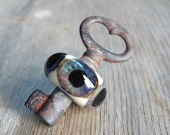 Glass Eye Skeleton Key Pendant