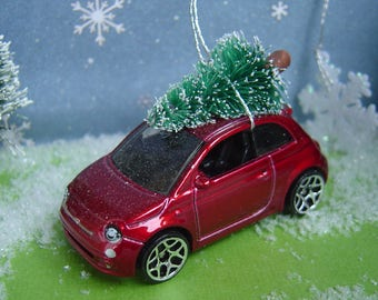 Fiat 500 car with Christmas tree ornament