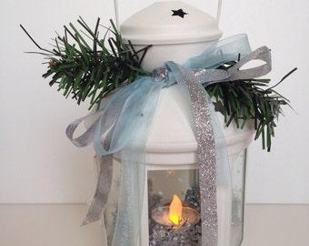 White Christmas lantern with silver snow decor