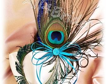 Flower gfirl basket peacock weddings royal blue and turquiose wedding colors.