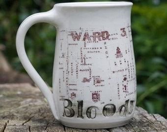 Murdoch Bloody Hell Mug made by Bunny Safari