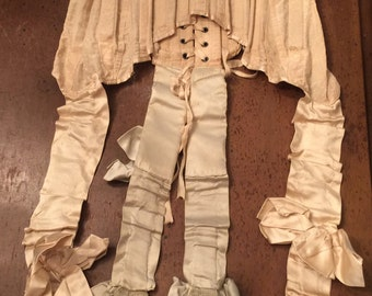 Sold.....Beautiful Antique Corset with silk hsrters snd bows