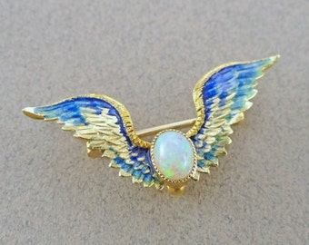 Fly away with Blue-Green Enameled Winged and Opal Brooch, made of 14k Yellow Gold, Late Victorian (A1846)