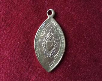 Sacred heart brass medal