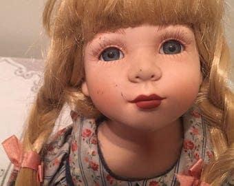 Blonde sitting Doll