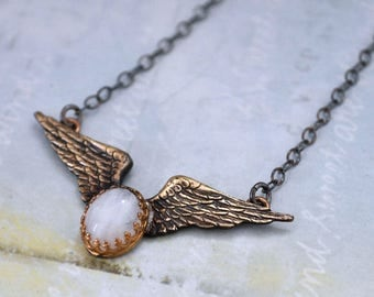 sterling silver wing necklace ANGELIC solid brass wing necklace with oxidized sterling silver chain and genuine moonstone cab