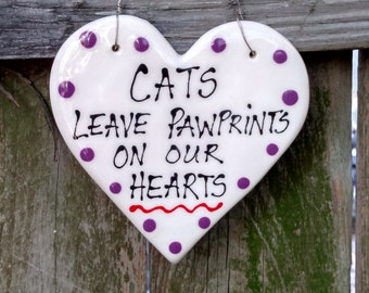 Cats leave pawprints on our hearts. Ceramic plaque.