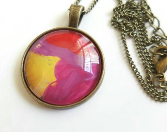 hand painted charm pendant, abstract round pendant, brass bezel pendant, original art pendant, wearable art jewelry, pink and yellow pendant