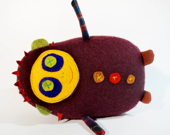 Dolores the Librarian stuffed Doll in maroon wool knit