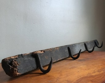 Vintage Rustic Forged Iron Wall Hooks on Wooden Beam