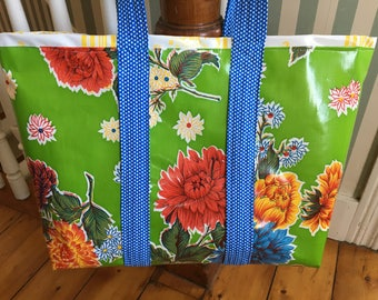 A country garden floral oilcloth tote bag on yellow/ green