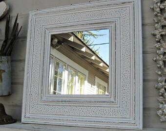 Ceiling tin tile mirror. 2'x2'.  Antique architectural salvage ceiling tin tiles. Creamy off-white wall mirror. Embossed tin.