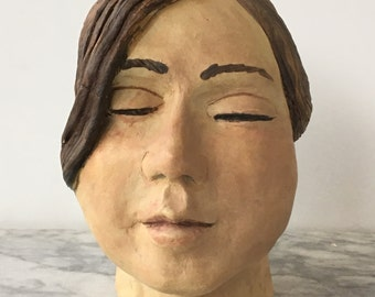 Portrait head of a girl, ceramic sculpture bust pony tail, stoneware happy face statue