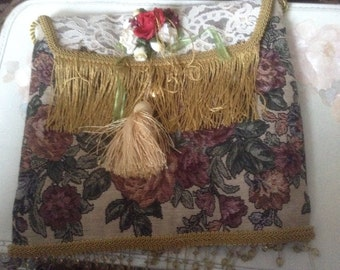 Victorian olive green tapastry purse or tote with green trim, with rope handle and snap