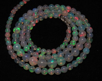 Welo Ethiopian Opal - 22 Inches  -  High Quality Smooth Polished Round Ball Beads Full Color Full Flashy Fire size - 4 - 7 mm approx