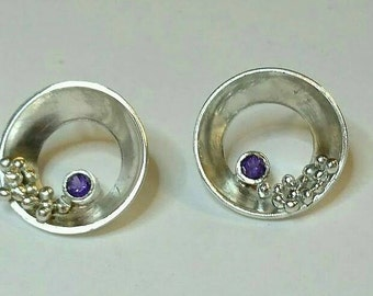 Sterling silver handmade granulation disc earrings with 3m faceted amethyst gemstones, hallmarked in Edinburgh.