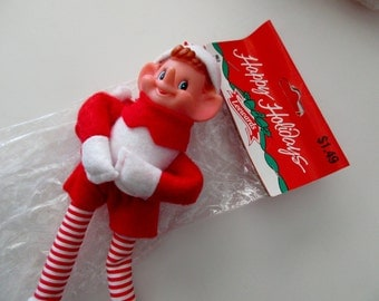 "vintage Leewards new old stock CHRISTMAS red elf - new in package, 7"" ornaments, poseable, bendable"