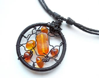 Wire wraped pendant with Baltic amber, solid copper varnished wire, natural Baltic amber bead and waxed cotton string with sliding knots