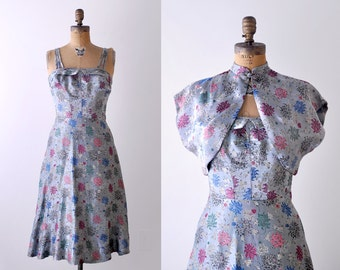 1950 Hawaiian dress. brocade. 50's floral dress. blue. asian knot. bolero. satin. silver. s.