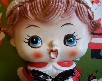 big eyed christmas caroler figurine