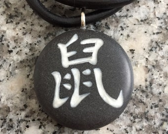 RAT Chinese Zodiac signs hand carved on a polymer clay black color background.  Pendant comes with a FREE necklace