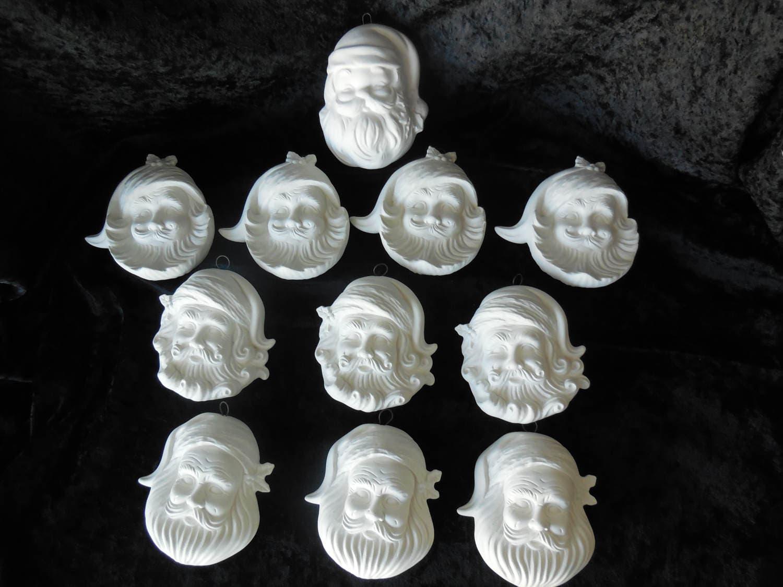eleven ready to paint ceramic santa face christmas tree