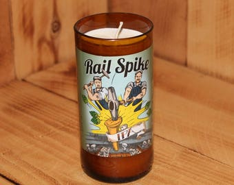 Hand Poured Soy Candle in Handmade Upcycled Rusty Rail Rail Spike IPA beer bottle glass made from a 12oz bottle