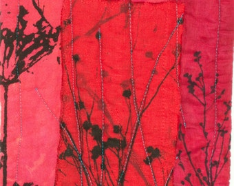 bright red and pink mini quilt long hot pad hand dyed and printed with with flower seed pods and wild sweet pea
