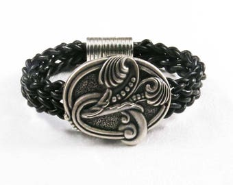 Metallic flower on black braided leather bracelet
