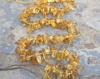 Citrine Nuggets, medium size, 10 to 15 mm long  (x 5 mm thick approx) 16 inch strand