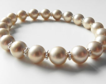 Shell pearl and silver tone daisy spacer stretch bracelet. Choice of colours.