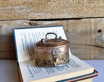 Brass cricket box. Small brass box with lid and small feet.