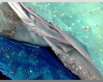 """Photo notecard of glittery, silvery and blue prom dresses; 5.5""""x4.25""""; blank."""
