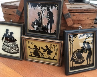 Silhouette collection of four vintage reverse painted on glass couples
