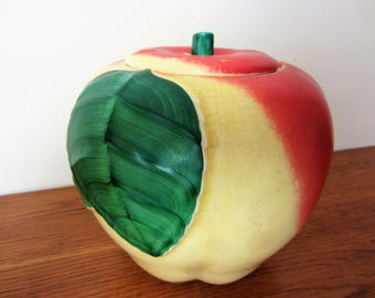 A vintage apple cookie jar.