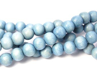 10mm Faded Light Blue Wood Beads -16 inch strand