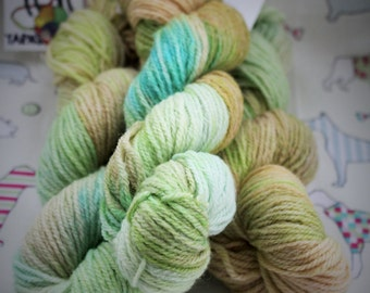 Hand dyed DK yarn. Green, turquoise and sand colour. A Cornish summers day. 50gms.
