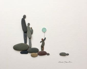 Pebble Art by Sharon Nowlan, family of four with new baby  pebble art comes matted or framed in 12 by 12 frame.